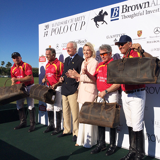 John Walsh and his team of polo legends Carlos Gracida, Memo Gracida and Mike Azarro celebrate receiving Tusting Aztec Weekenders from The Hon Hilary Weston