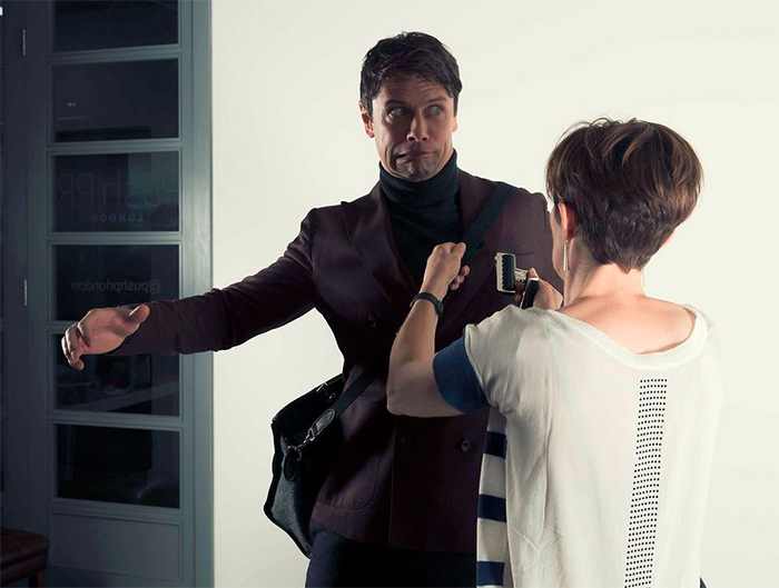 Leon Ockenden takes fright at an approaching bulldog clip whilst modelling for Tusting luxury leather luggage