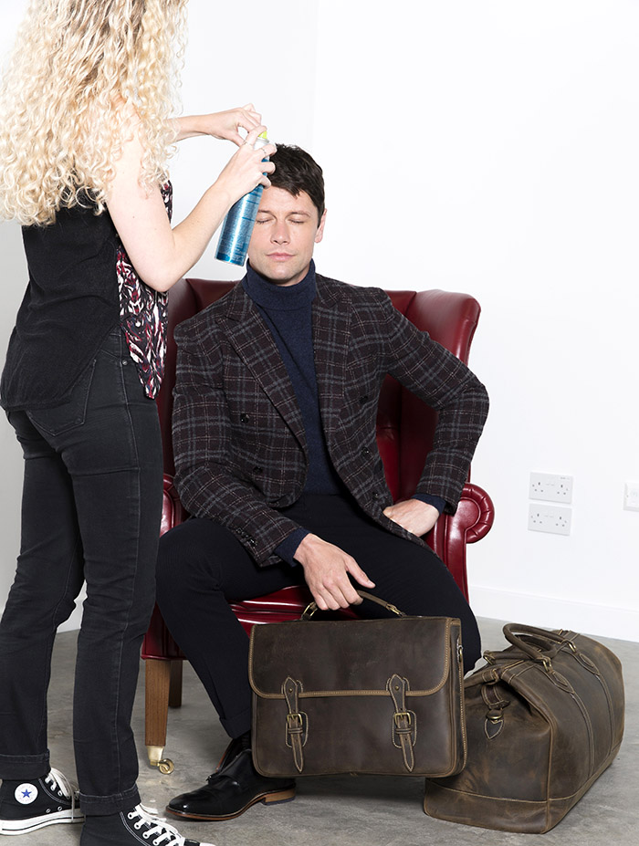 Leon Ockenden gets the finishing touches to his hair and makeup during the TUSTING leathergoods AW15 photoshoot