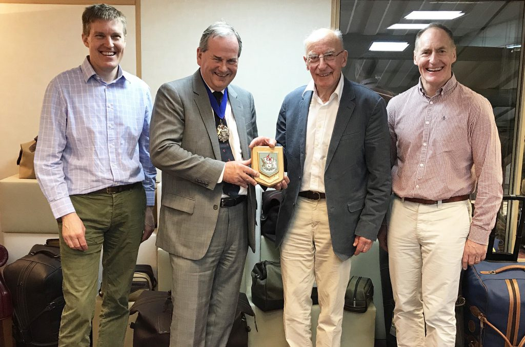 Ian Russell, Master of the Leathersellers Company presents a commemorative plaque to Alistair, John and William Tusting