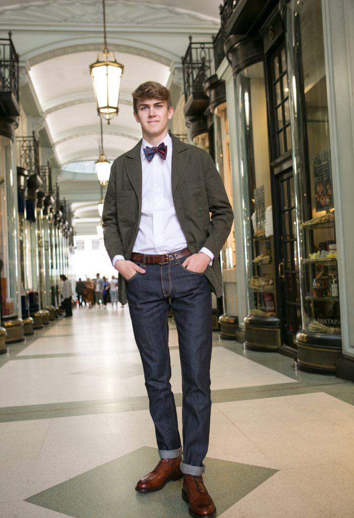 Fin Tusting models a slim fit shirt and paisley bow tie by Budd Shirtmakers, jeans by Forge Denim and blazer by Realm and Empire. Shoes are Skye brogue boots from Crockett and Jones